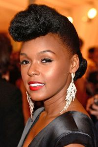 A slightly quieter version of her signature look at the 2012 Met Gala... Essence.com